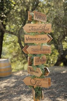 An Eclectic Literature Themed Wedding enchanted forest woodland wedding with rustic whimsical wooden signs inspired by fiction books narnia wonderland Oz as table names / numbers Enchanted Forest Prom, Enchanted Forest Decorations, Enchanted Wedding Themes, Enchanted Wood, Forest Themes, Forest Wedding Decorations, Enchanted Forest Quinceanera Theme, Enchanted Wedding Inspiration, Enchanted Forest Bedroom