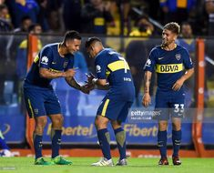 Edwin Cardona of Boca Juniors celebrates with Cristian Pavon after scoring the second goal of his team during a match between Boca Juniors and Arsenal as part of the Superliga at Alberto J. Armando Stadium on December 2017 in Buenos Aires, Argentina. Neymar, Messi, Arsenal, Snapchat, Goal, Two By Two, December, Football, Stock Photos