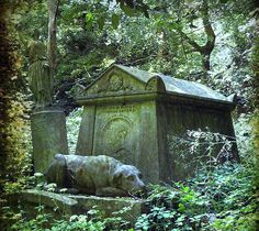 A grave at Highgate Cemetery in London depicts a statue of the owner's dog resting by his master's side. flickriver.com
