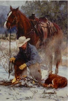 Cowboy warmng his hands over a fire, saving a calf. #horse