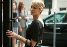 Robin Wright Pennin House of Cards. So inspirational in her Lady Macbeth role. Every poised movement denotes composure and power. Note this dress; why flaunt a crepey decoletage when a strong back is just as alluring.