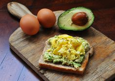 Scrambled eggs & mashed avocado on toasted rye slice of bread