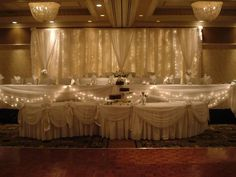 Tiered wedding head table w/ lighted backdrop, serpentine dessert table - Royale Ballroom at the Crowne Plaza Lansing West