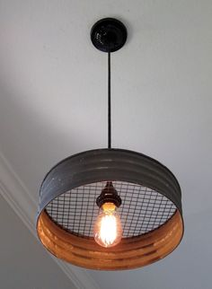 What a great light! Made with a grey corrugated metal that looks just like it came from an old farmhouse. This would make a great addition to a kitchen, laundry room, mudroom, barn, etc. The diameter #MetalBuildings
