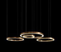 Pendant energy saving LED lamp with warm light, formed with rings of various sizes and types of illumination; incorporating transformers in the ceiling..