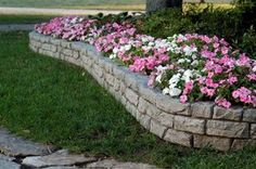 Easy (and inexpensive) way to build raised beds and retaining walls that look like real stone - Curved RockLock Wall System