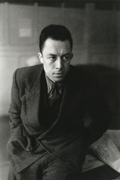 """Albert Camus, 1945. Photographed by Henri Cartier-Bresson - """"We turn our backs on nature; we are ashamed of beauty. Our wretched tragedies have a smell of the office clinging to them, and the blood that trickles from them is the color of printer's ink."""" Albert Camus, """"Helen's Exile""""  1948. S)"""