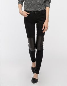Front: Jet black, mid-rise skinny jeans from J Brand with soft, ribbed lambs leather paneling stretch fit, YKK zip fly and button closure.
