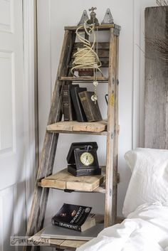 To add a bedside storage table and shelf in a tight space, Donna, of Funky Junk . To add a bedside storage table and shelf in a tight space, Donna, of Funky Junk Interiors beefed up an old ladder with salvaged boards for shelves and wall supports. Vintage Ladder, Rustic Ladder, Antique Ladder, Vintage Home Decor, Rustic Decor, Farmhouse Decor, Farmhouse Shutters, Red Farmhouse, Country Decor