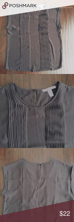 Gray pleated top Gray silk pleated top. Cap sleeve. Gold button detail in back. Only worn a couple of times. Excellent condition. Forever 21 Tops Blouses