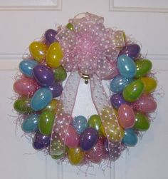 "Step by step on how to make this cute Easter Egg Wreath!  So fun!  The ""Mom's Craft Night Out"" is such a cute idea too!  Hmmmmm....."