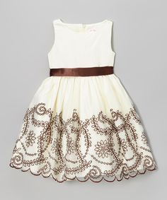 Take a look at this Ivory Rosette Ruffle Cascade Dress - Toddler & Girls on zulily today!