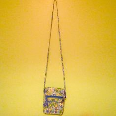 A Vera Bradley cross body 3 big packets 3 tiny packets inside and a place to put ID Vera Bradley Bags Crossbody Bags