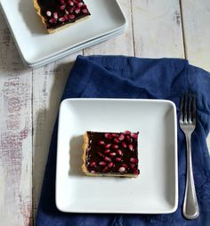 In this dessert the tart pomegranate syrup and fresh seeds provide the perfect contrast to the rich chocolate and sweet shortbread crust.
