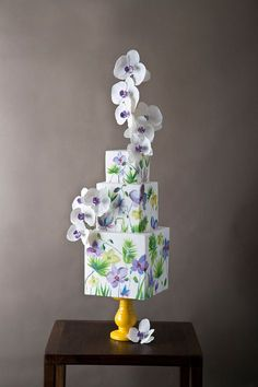 Square tiered purple and green hand-painted wedding cake with cascading orchids // Top 10 Wedding Cake Creators in Malaysia - Part 1 Wedding Cake Fresh Flowers, Unique Wedding Cakes, Beautiful Wedding Cakes, Gorgeous Cakes, Wedding Cake Designs, Wedding Cake Toppers, Amazing Cakes, Pretty Cakes, Purple Wedding