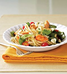 Need a new way to serve salmon? Try this summery salad. The salmon is served with tomatoes, goat cheese, pasta, and greens to make a healthy main dish. 19 pts+ but there's room to modify to lower that