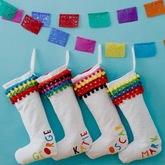 personalised pom pom christmas stocking by what katie did next   notonthehighstreet.com
