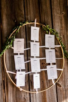 Wooden Embroidery Hoops and Fresh Greenery Make for a Darling Seating Chart Display at This Pumpin Inspired Fall Farm Wedding