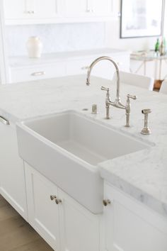"Countertop is ""Statuarietto Marble"" with a honed finish.  Faucet: Rohl Perrin and Row faucet.  Farmhouse Sink: Rohl Shaw sink."