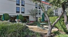 Hampton Inn San Antonio Northwoods San Antonio This hotel is located 20 minutes outside of downtown San Antonio and the River Walk. The hotel offers guests a continental breakfast, business center and an outdoor swimming pool.