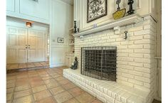 Love a white brick fireplace