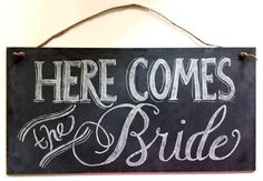 Here comes your girl -black board from Michaels and paint pen. twine. Backside says: And they live happily ever after