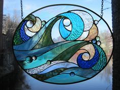 Ocean Wave Stained Glass Panel by RenaissanceGlass on Etsy, $265.00 #StainedGlassPanels