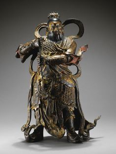 Guardien en bronze laqué or Dynastie Ming, XVIIE siècle  A LACQUER-GILT BRONZE FIGURE OF A HEAVENLY GUARDIAN, MING DYNASTY, 17TH CENTURY