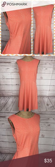 Orange A-Line Fit & Flare Dress NWT This bright and beautiful orange is the perfect shade for spring. It has small white designs all over and a u-shaped seam at the waist line. Sleeveless with a high neck crew and a midi skirt. New with tags. Apt. 9. Polyester/Spandex blend. Size L. Apt. 9 Dresses
