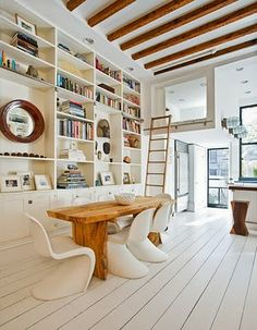 Very light with white Panton Chairs.