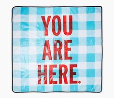 Kate Spades playful picnic blanket is crafted of a durable material and enlivened with a bright ...