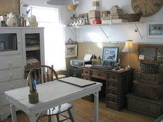 Vintage cabinet, refronted with glass, wicker picnic baskets for storage, antique desk for computer, simpler white desk for craftwork