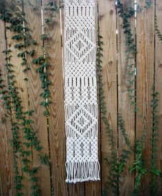 Add texture and fun to your table with this modern macramé table runner. This piece is handwoven using 1/8 3 strand cotton rope in a natural