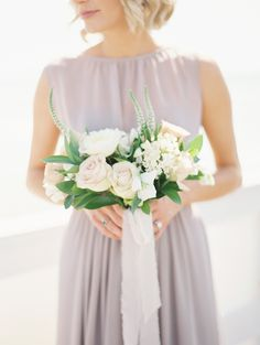 Photography : Carmen Santorelli Photography | Floral Design : Plenty Of Petals | Wedding Dress : J. Crew | Bridesmaids Dresses : Jenny Yoo Read More on SMP: http://www.stylemepretty.com/2015/05/15/dusty-blue-lavender-spring-garden-wedding/