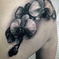 Guys White And Black Shaded Orchid Back Of Shoulder Tattoos
