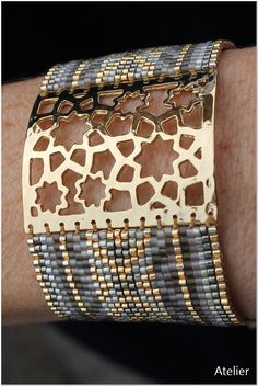 Stunning Bracelet with gold plated panel by Atelier Home & Garden (UK). Simple sliding tie fastening at back.