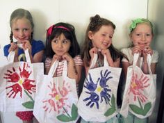 daisy bags  OR each girl is a different color so the flowers have one handprint in each color. At the same time make a hand towl for Mom & Grandmom's for Mother's Day.