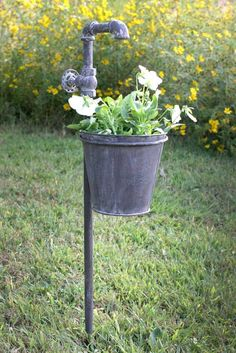 This charming garden stake features a faucet with spigot knob on top, and a planter below to give the appearance that water is running into the plant. The weathered metal look of this item adds to its(Diy Garden Stakes) Garden Stakes, Garden Planters, Potager Garden, Herb Garden, Hanging Planters, Diy Garden Decor, Garden Art, Garden Shop, Vintage Garden Decor