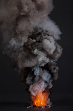 Photos of fire and smoke inspired by the use of smoke signals as a means of communication during Papal conclaves.