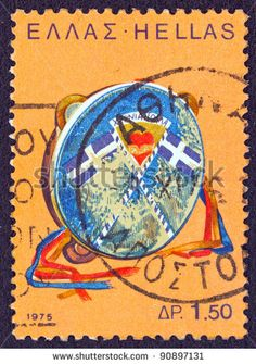 """GREECE - CIRCA 1975: A stamp printed in Greece from the '""""traditional musical instruments"""" issue shows a tabor (nteffi), circa 1975."""