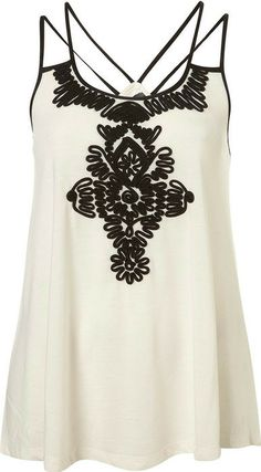 Topshop Black  and White Blouse... Not exactly my style, but I like the design on the front &  the straps are cool