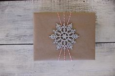 Easy DIY Christmas gift wrap using a snowflake ornament!