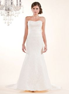Dasia style 8367  This romantic lace gown has a scooped strapless neckline and A-line skirt, enhanced by a wide sash at the natural waistline and covered buttons down the back. Shown in Cream Pearl and also available in White and Pearl.