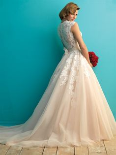 STYLE: 9272 Transparent lace composes the back and cap sleeves on this ethereal ballgown. Accessorize with a sash or let the lace speak for itself.