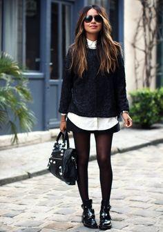 Bottines loose + collants fins + mini jupe noire + chemise blanche + pull gris noir + cheveux longs + lunettes de soleil