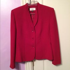 Like new red suit with flutter detain on skirt Like new red suit with flutter detain on skirt. Only worn twice. 100% polyester with lining. 3 button jacket, zipper on back of skirt. Le Suit Dresses