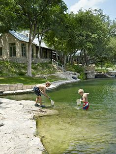 Willcott and Miller dammed a creek on their Texas property to widen the swimming hole enjoyed by their grandchildren, including Jesse (left) and Bentley.  Read more: Judy Wilcott and Laurence Miller Texas Ranch - Texas Ranch Decorating Ideas Follow us: @Country Living Magazine on Twitter | CountryLiving on Facebook Visit us at CountryLiving.com