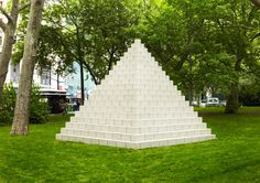 "Pyramid (Münster), 1987, Concrete Blocks: In 1982, Sol LeWitt began to work with concrete blocks.  As a common, readily available building material, it appealed to him as a modular component.  The artist first discussed this kind of form – horizontal steps of progressively decreasing width – in a 1966 article entitled ""Ziggurats.""  Different perspectives reveal the structure as a stepped pyramid or half-cube, suggesting the convergence of architecture and sculpture in LeWitt's work."""