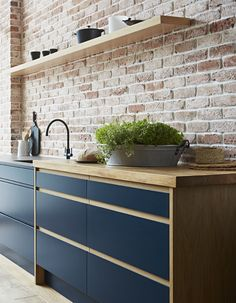 Modern industrial style kitchen - Pure handleless kitchen from John Lewis of Hungerford in deep, Cobalt Satin with Oak trim rebate handles. Kitchen Furniture, Kitchen Interior, New Kitchen, Kitchen Dining, Kitchen Decor, Decorating Kitchen, Brick Wall Kitchen, Kitchen Ideas, Spanish Kitchen