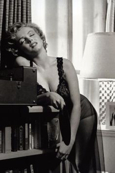 Harold Lloyd - Marilyn Monroe -  1952) - posing in lingerie, holding a record album - taken during a photo shoot at Marilyn's Los Angeles apartment by Philippe Halsm
